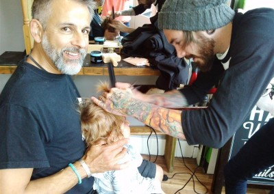 Dudleys first haircut, with Ryan at Banshanky, Bristol. Aug 2014